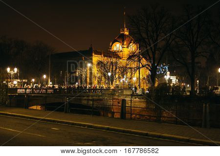 STRASBOURG FRANCE - DEC 20 2016: Night scene of Strasbourg with police military force searching the queue at the entrance of the Christmas Market with Palais du Rhin in the background