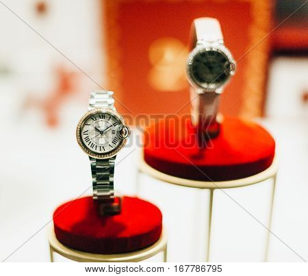 STRASBOURG FRANCE - DEC 20 2016: Luxury Cartier female watches with natural diamonds sapphire glass and gold covered. Cartier is a luxury high-end fashion jewlery house