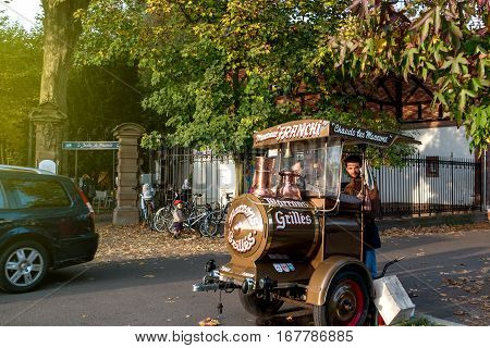 STRASBOURG FRANCE - NOV 1 2016: Monsieur Franchi hot chestnut maroons ambulant seller at the entrance of Orangerie Park in Central Strasbourg Alsace France
