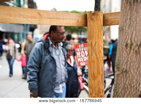 STRASBOURG FRANCE - MAY 14 2016: Flyer with text - Working Law No Thank you - with silhouete of black ethnicity man in French city