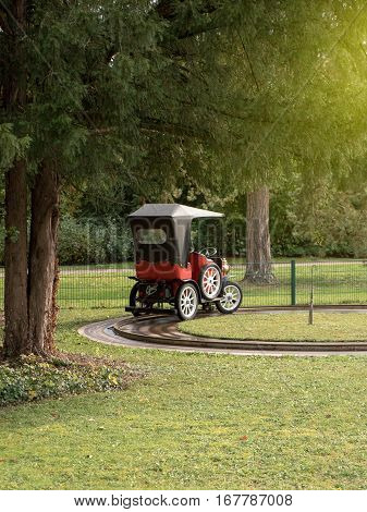 STRASBOURG FRANCE - OCT 24 2016: Vintage Opel car on rails in park as an attraction for little kids