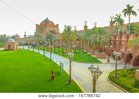 Green gardens outside of Emirates Palace a luxurious and most expensive 7 star hotel in Abu Dhabi. Abu Dhabi is a famous travel destination in United Arab Emirates. Luxury travel concept. Aerial view.