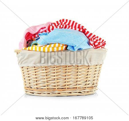 Clothes in wicker basket on white background
