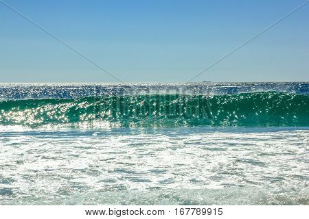 Big waves in Noordhoek Beach in a sunny day. Surfing in Cape Town, South Africa. Atlantic coast, Table Mountain National Park. Extreme sports leisure concept. Powerful waves background.