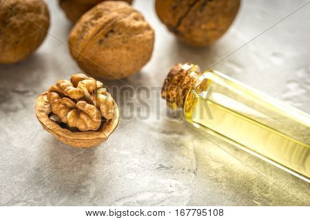 cosmetic and therapeutic walnut oil on gray background.