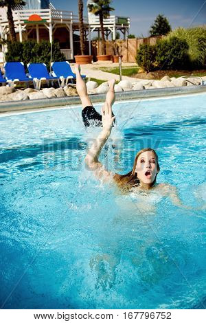 drowning girl being saved by a life guard