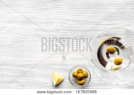 martini and shaker top view of wooden background.