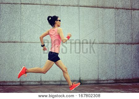 young fitness sport woman running on city