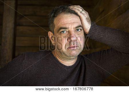 Sad man portrait. He clutched at his head.