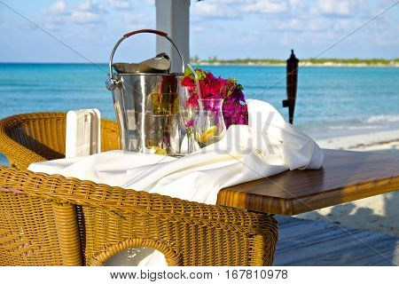 Beach side table with flowers and ice bucket