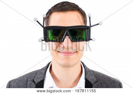 male engineer wearing 3d virtual-reality glasses with infrared targets