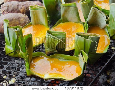 Grilled omelet or egg omelette on banana leaf (traditionally named as Khai Parm Khai pam or Ogg Khai) traditional thai food northern style which is made without any fat oil