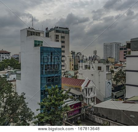 Old buildings in Ho Chi Minh City in dark cloudy morning