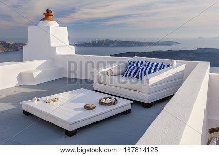 View of Firostefani luxury decks and patios, Santorini Greece. Copyspace