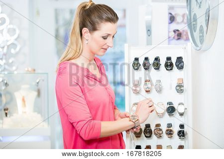 Female customer in store looking for wristwatches