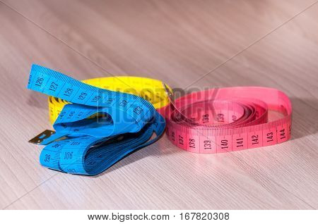 Blue red and yellow centimeter on the table