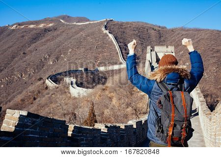 Tourist Raising Hands In Great Wall Of China In Joy - Travel In China, Asia Concept