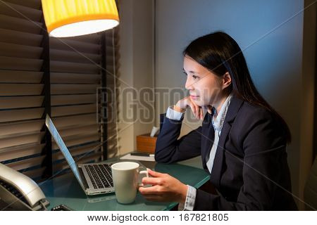 Business woman looking at laptop computer