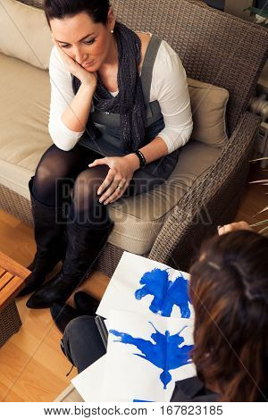 a young woman is taking a rorschach test at her therapist's