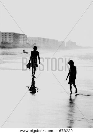 Silhouette Father And Son Walking On A Beach