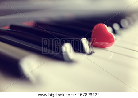 Red heart on piano keyboard keys concept for love of music or romance and valentines day