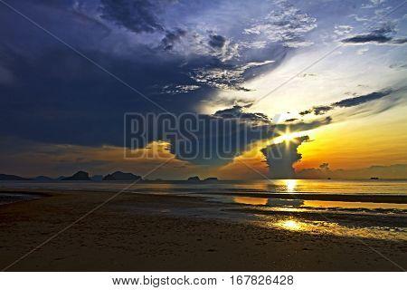 Sunrise and sand beach at Arunothai Beach in Chumphon Province Thailand.