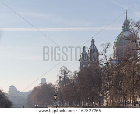 MUNICH - JANUARY 28: View on a city center from the bridge on river Isar in Munich Germany. View on St. Luke's Church - the largest Roman Catholic church in Munich southern Germany