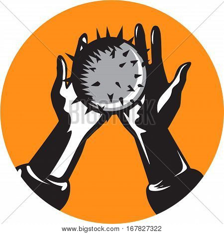 Illustration of pair of hands holding a round shiny ball with numerous spikes set inside circle on isolated background done in retro woodcut style.