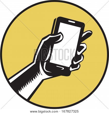 Illustration of a hand holding smartphone set inside circle on isolated background done in retro woodcut style.