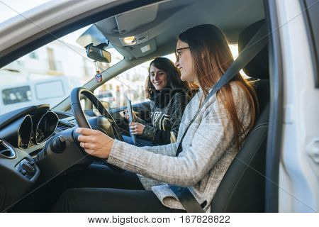 Driving instructor teaching a student in a car