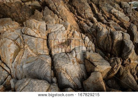close up background and texture of break granite stone at Banana Beach Phuket Province Thailand.