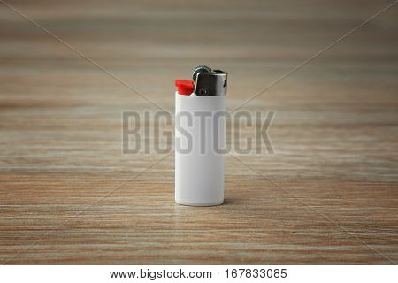 Blank white cigar lighter on wooden background