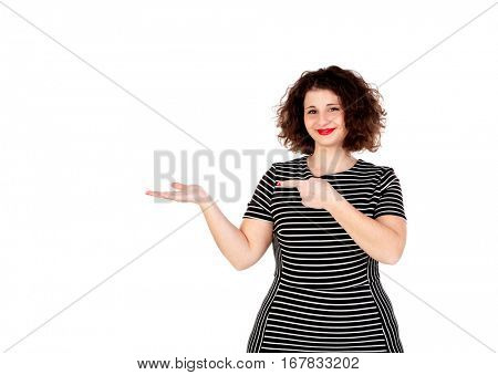 Beautiful curvy girl with striped dress indicating something with the finger isolated on a white background