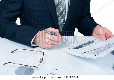 Businessman analyzing financial figures denoting the progress in the work of the company on a white background.