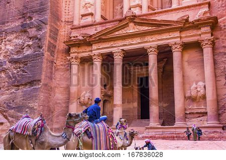 PETRA, JORDAN - NOVEMBER 26, 2016 Rose Red Treasury in Afternoon Becomes Golden in Morning Camels Siq Petra Jordan Petra Jordan.
