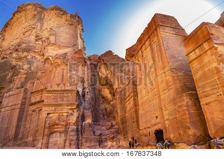 Yellow Rock Tombs Morning Street of Facades Petra Jordan. Built by the Nabataens in 200 BC to 400 AD. Yellow rock tombs become rose red in the aftrnoon when the sun goes down. Reds are created by magnesium in sandstone.