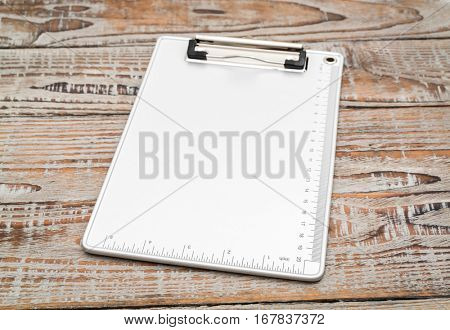 Clip board on wood  background
