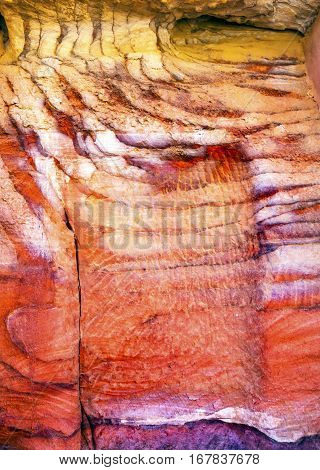 Red White Rock Abstract Petra Jordan Built by the Nabataens in 200 BC to 400 AD. Rose Red canyon walls create many abstracts close up. Inside the Tombs the rose red can become blood red. Reds are created by magnesium in sandstone.