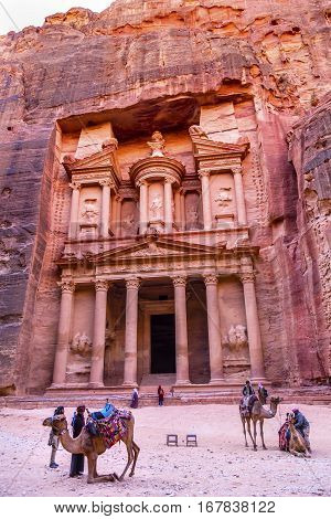 PETRA, JORDAN - NOVEMBER 26, 2016 Yellow Treasury in Morning Becomes Rose Red in Afternoon Camels Siq Petra Jordan Petra Jordan.