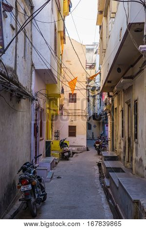 Udaipur, India - January 29, 2017: Walking In The Enchanting Narrow Alleys And Streets At Udaipur, F