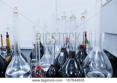 Lab beakers and flasks with different solutions