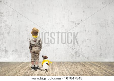 Little scout with dog indoors