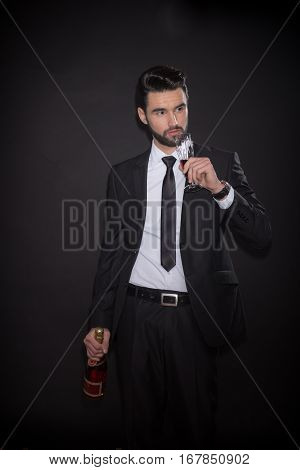 Young Man Bottle Alcohol Drinking Glass Suit Elegant