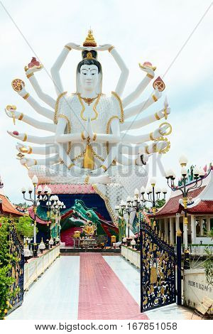 18 Hands God Statue (guanyin) On Background Of Blue Sky In Temple On Samuii,thailand