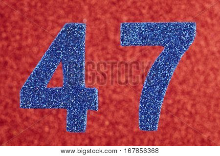 Number forty-seven blue color over a red background. Anniversary. Horizontal