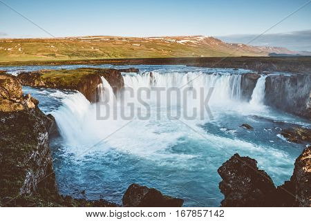 Great view of powerful Godafoss cascade. Popular tourist attraction. Gorgeous scene. Location Bardardalur valley, Skjalfandafljot river, Iceland, Europe. Vintage effect. Instagram filter. Beauty world