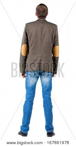 Back view of business man in jacket  looking up.  Standing young guy in jeans and suit jacket. Rear view people collection.  backside view of person.  Isolated over white background.