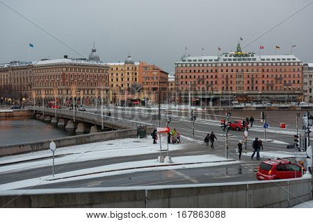 STOCKHOLM, SWEDEN - NOVEMBER 27, 2016: Traffic on the Strombron bridge in a winter day. Built in 1946, the bridge is connecting the old city Gamla stan to the northern-central district Norrmalm