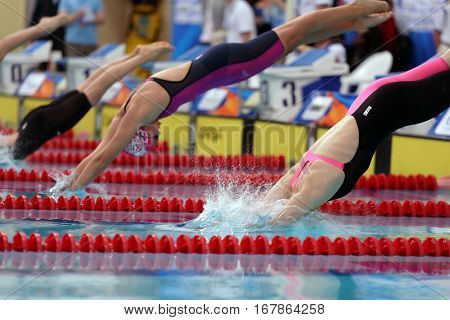 ST. PETERSBURG, RUSSIA - DECEMBER 17, 2016: Start of women 200 m breaststroke swimming competition during X Vladimir Salnikov Cup. Athletes from 6 countries participated in the competitions