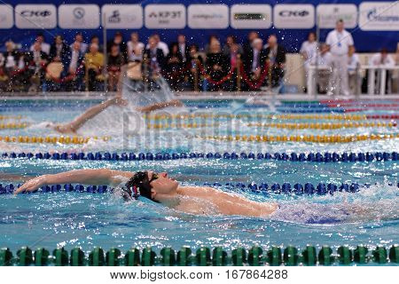 ST. PETERSBURG, RUSSIA - DECEMBER 17, 2016: Athletes compete in 200 m backstroke swimming competition during X Salnikov Cup. Athletes from 6 countries participated in the competitions